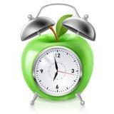 Green apple alarm clock Royalty Free Stock Images