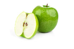 Green apple and apple slices on a white background. Juicy fresh green apple and apple slices on a white background Royalty Free Stock Photography