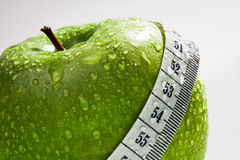 Green apple as concept of healthy diet. On white background Royalty Free Stock Image