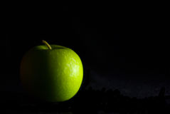Green Apple Background. A green apple, on a black studio background Stock Photo