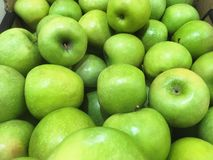 Green apple background in supermarket Royalty Free Stock Photos