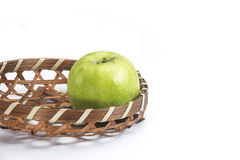 Green apple in the basket royalty free stock image