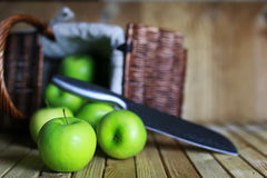 Green apple in a basket Royalty Free Stock Photography