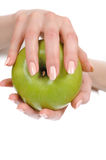 Green apple in a beautiful hand of woman Stock Images