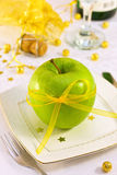Green apple with a beautiful ribbon Royalty Free Stock Image