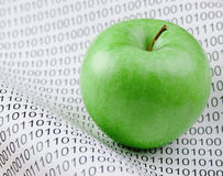 Green apple and binary code. Green apple on a binary code Royalty Free Stock Photo