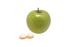 Green apple and biscuits Royalty Free Stock Image