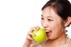 Green apple bite. Asian woman taking a bite on green apple, isolated on white Royalty Free Stock Images