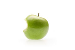 Green apple with bite. On white Stock Photos