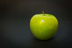 Green apple on the black background.  royalty free stock photos