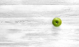 Green apple on black and white wood background Royalty Free Stock Images