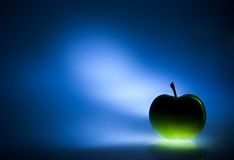 Green apple on blue  background Royalty Free Stock Images