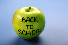 Green apple on blue background. Back to school concept Stock Photo