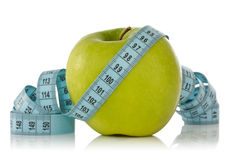 Green apple with a blue measure tape Royalty Free Stock Images