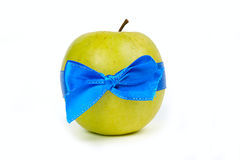 Green apple with blue ribbons Stock Photos