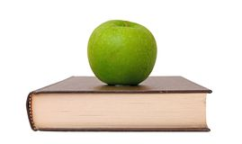 Green apple and book Royalty Free Stock Photography
