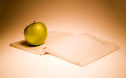 Green apple and book Stock Image