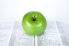 Green apple on the book Royalty Free Stock Photos