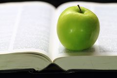 Green apple on a book Stock Photo