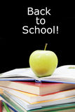 Green apple with book for school Royalty Free Stock Photography