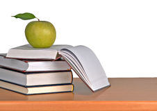 Green apple on books Royalty Free Stock Images