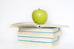 Green apple and  books Stock Photos