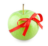 Green apple with a bow. On white background royalty free stock photo