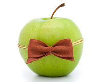 Green apple with bow-tie Stock Photography