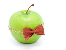 Green apple with bow-tie Stock Images