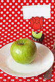 Green apple for breakfast clothespin with card Royalty Free Stock Photos