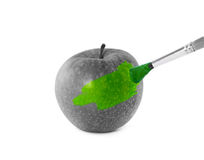 Green apple and brush Royalty Free Stock Photo