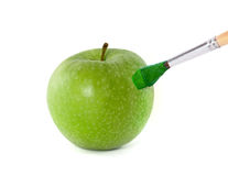 Green apple and brush Royalty Free Stock Photography