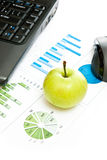 Green apple and business Royalty Free Stock Images