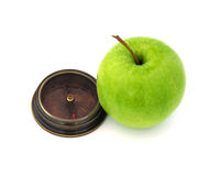 Green  apple  with c ompass , isolated on white background Royalty Free Stock Photos