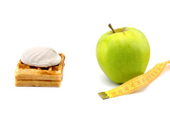 Green apple and cake with centimeter on a white background Stock Photo