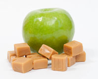 Green Apple with Caramels Stock Photo