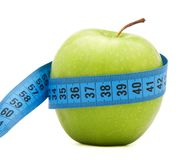 Green apple with centimeter Stock Images