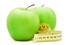 Green apple with centimeter. Royalty Free Stock Photo