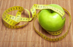 Green apple with centimeter Royalty Free Stock Images