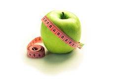 Green apple with centimeter - losing weight Stock Photos