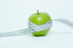 Green apple and centimeter Royalty Free Stock Photo
