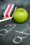 Green apple on chalkboard Royalty Free Stock Images
