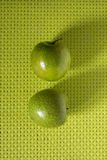 Green apple on checkered texture Stock Image