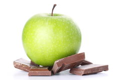 Green Apple and Chocolate Bar Stock Image