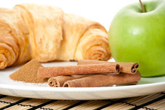Green apple, cinnamon, cornetto Royalty Free Stock Photography