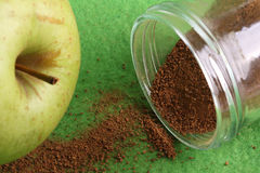 Green apple with cinnamon in jar Stock Photography