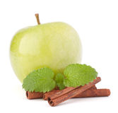 Green apple, cinnamon sticks and mint leaves still life Royalty Free Stock Photos