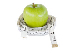 Green apple circled with a tape measure Stock Photo