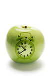 Green Apple and Clock Royalty Free Stock Images