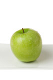 Green Apple Closeup on White Plate Royalty Free Stock Image